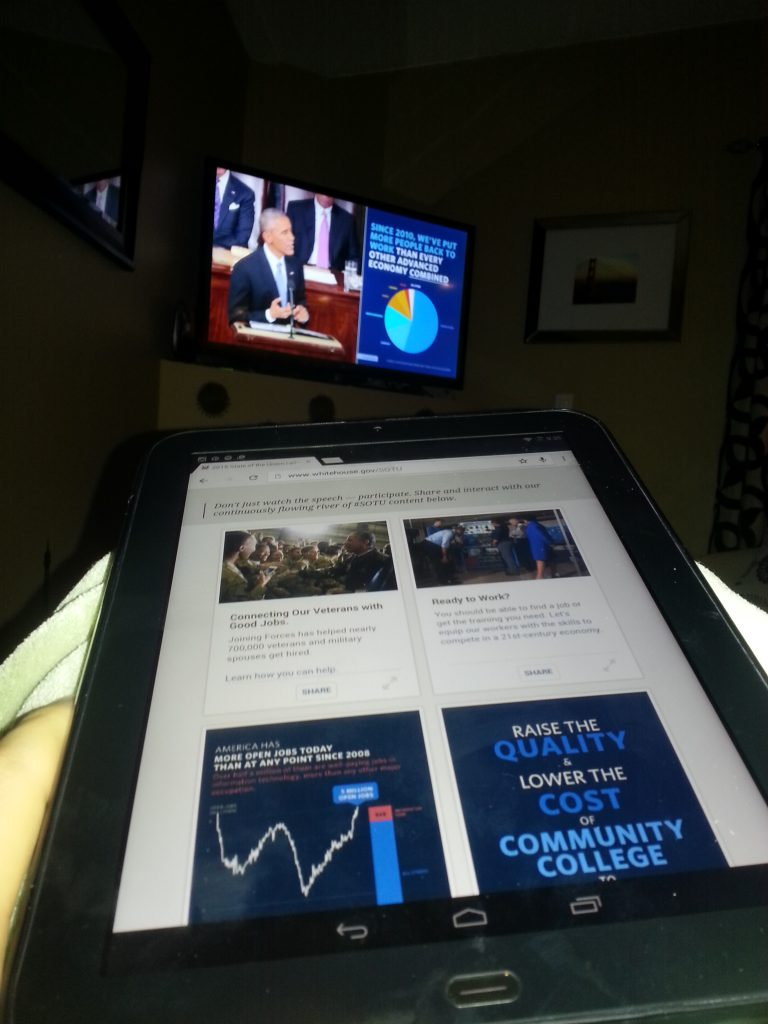 Simultaneously watching the SOTU on Youtube with sidebar content and companion tablet content.