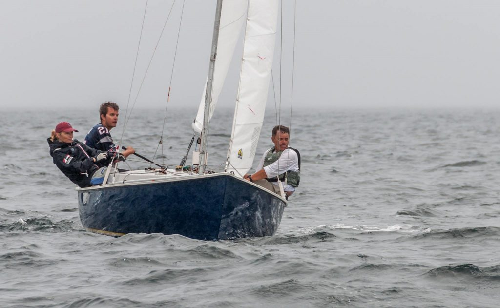 Jim Taylor, Nat Taylor & Cindy Smith sail upwind at the 2015 Rhodes 19 National Championship